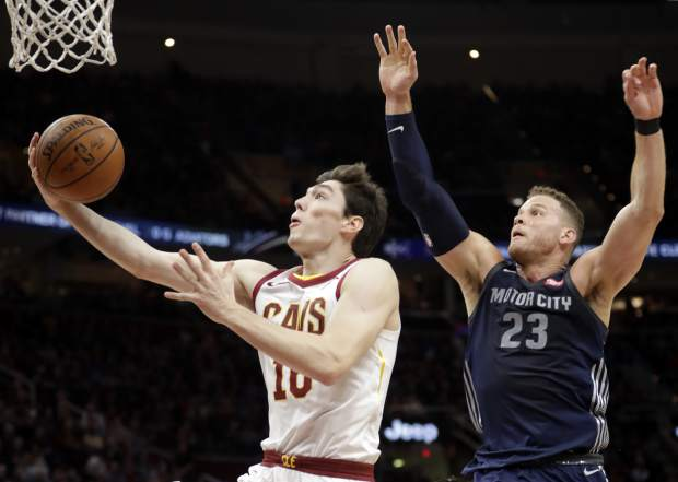 Cleveland Cavaliers' Cedi Osman (16), from Turkey, drives to the basket against Detroit Pistons' Blake Griffin (23) in the first half of an NBA basketball game, Monday, March 5, 2018, in Cleveland. (AP Photo/Tony Dejak)