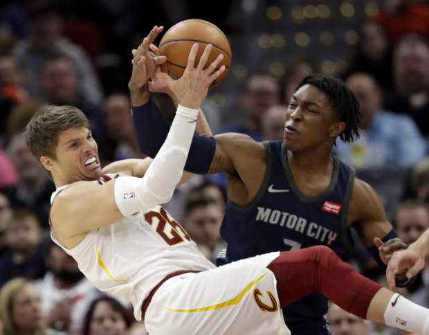 Cleveland Cavaliers' Kyle Korver, left, and Detroit Pistons' Stanley Johnson battle for a loose ball in the first half of an NBA basketball game, Monday, March 5, 2018, in Cleveland. (AP Photo/Tony Dejak)