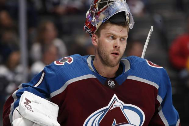 Colorado Avalanche goaltender Semyon Varlamov waits during a timeout in the second period of an NHL hockey game against the Nashville Predators, Sunday, March 4, 2018, in Denver. (AP Photo/David Zalubowski)