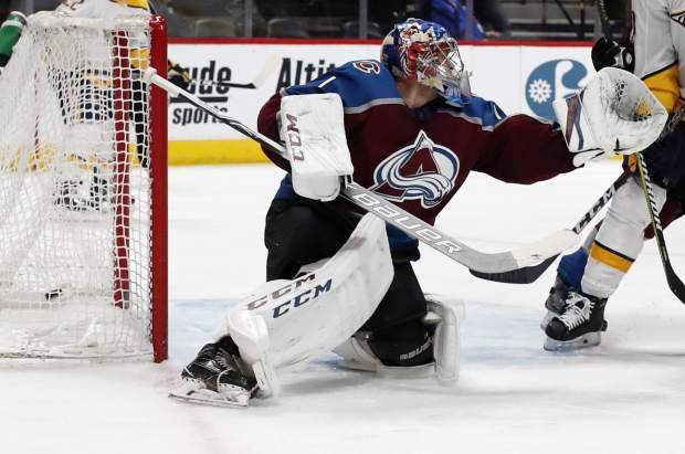 Colorado Avalanche goaltender Semyon Varlamov fails to stop a shot off the stick of Nashville Predators center Kyle Turris that goes in the net for a goal in the second period of an NHL hockey game Sunday, March 4, 2018, in Denver. (AP Photo/David Zalubowski)