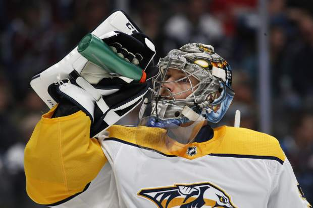 Nashville Predators goaltender Pekka Rinne drinks during a timeout against the Colorado Avalanche in the first period of an NHL hockey game Sunday, March 4, 2018, in Denver. (AP Photo/David Zalubowski)