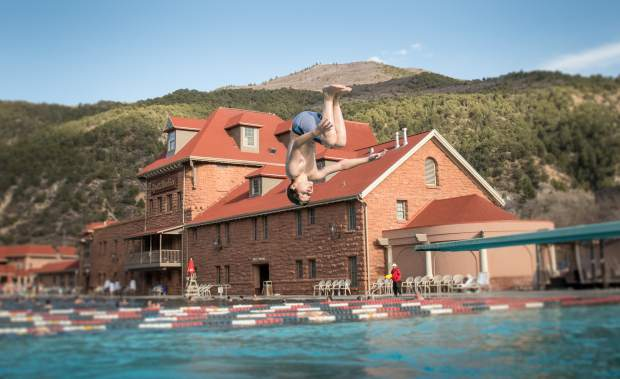 Dion Olson has fun at the Glenwood Hot Springs Pool while visiting from Arvada on a chilly and breezy Monday afternoon. While many locals are out of town for spring break, many visitors are in town for their spring break getaway.