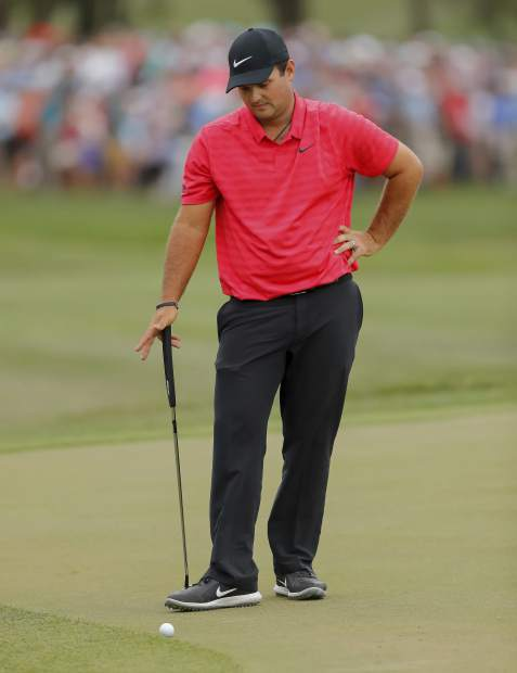 Patrick Reed reacts as his putt attempt rolls back to him on the 18th hole during the final round of the Valspar Championship golf tournament Sunday, March 11, 2018, in Palm Harbor, Fla. (AP Photo/Mike Carlson)