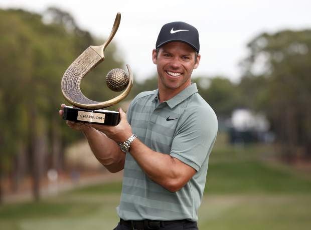 Paul Casey holds up the champion's trophy after winning the Valspar Championship golf tournament Sunday, March 11, 2018, in Palm Harbor, Fla. (AP Photo/Mike Carlson)