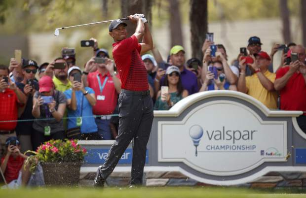Tiger Woods plays his shot from the second tee during the final round of the Valspar Championship golf tournament Sunday, March 11, 2018, in Palm Harbor, Fla. (AP Photo/Mike Carlson)