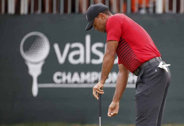 Tiger Woods reacts to a missed putt on the 12th hole during the final round of the Valspar Championship golf tournament Sunday, March 11, 2018, in Palm Harbor, Fla. (AP Photo/Mike Carlson)