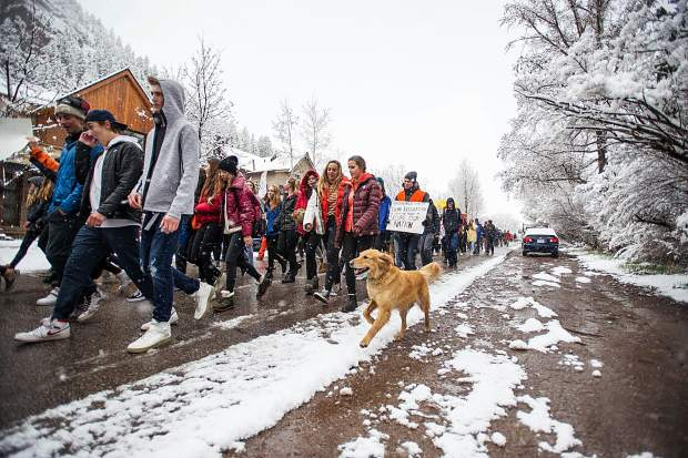 Golden retriever Lily joined students of Aspen High School marching towards Paepcke Park on Friday for a student-organized walkout addressing all of the school shootings and gun control.