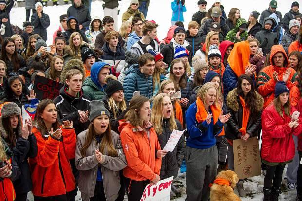 Aspen High School students and supporters listen and cheer to speakers at Paepcke Park on Friday for a student-organized walkout addressing all of the school shootings and gun control.