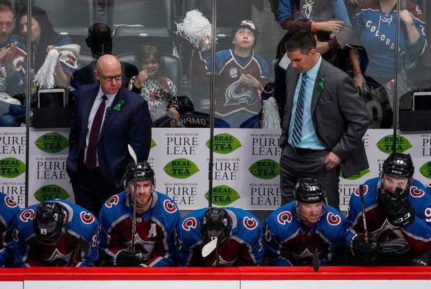 Colorado Avalanche head coach Jared Bednar, right, Ray Bennett, left, along with Matt Nieto (83), Blake Comeau (14), J.T. Compher (37), Sven Andrighetto and Mikko Rantanen hang their heads in the third period of Game 6 of an NHL hockey first-round playoff series against the Nashville Predators, Sunday, April 22, 2018, in Denver. Nashville beat Colorado 5-0 to win the first-round series. (AP Photo/Jack Dempsey)