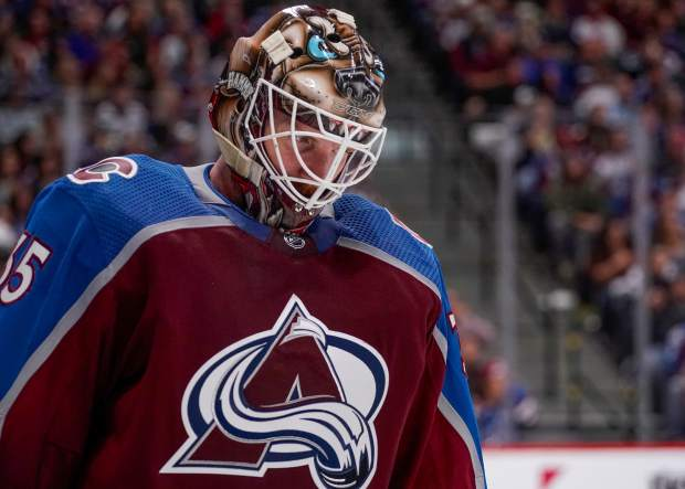 Colorado Avalanche goaltender Andrew Hammond reacts after giving up a goal to the Nashville Predators during the second period in Game 6 of an NHL hockey first-round playoff series Sunday, April 22, 2018, in Denver. (AP Photo/Jack Dempsey)