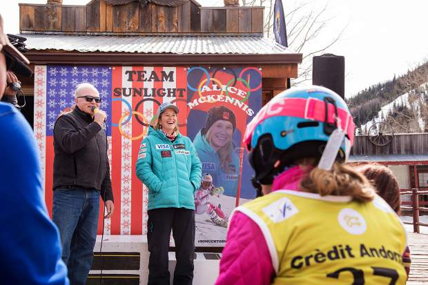 Alice McKennis flashes a big smile at the ski run naming dedication Saturday at Sunlight Mountain Resort, as Sunlight General Manager Tom Jankovsky does the honors.
