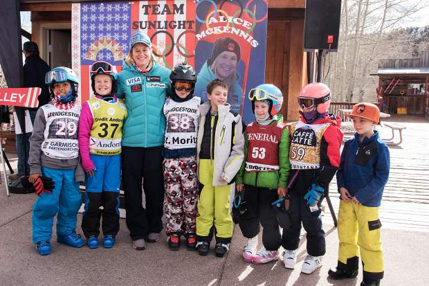 Alice McKennis poses with several Buddy Werner ski team members at Sunlight Mountain Resort, where a ski run was renamed in the Olympian's honor.