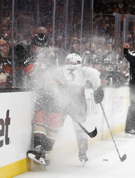 Colorado Avalanche's Matt Nieto, right, avoids a check from Anaheim Ducks' Marcus Pettersson during the first period of an NHL hockey game Sunday, April 1, 2018, in Anaheim, Calif. (AP Photo/Jae C. Hong)