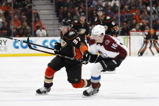 Anaheim Ducks' Nick Ritchie, left, skates past Colorado Avalanche's Nikita Zadorov during the second period of an NHL hockey game Sunday, April 1, 2018, in Anaheim, Calif. (AP Photo/Jae C. Hong)