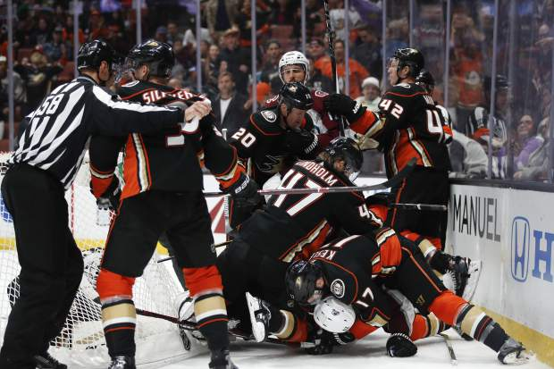 Players pile up during the first period of an NHL hockey game between the Anaheim Ducks and the Colorado Avalanche on Sunday, April 1, 2018, in Anaheim, Calif. (AP Photo/Jae C. Hong)