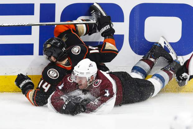 Anaheim Ducks' Adam Henrique, left, and Colorado Avalanche's Tyson Barrie tumble to the ice during the third period of an NHL hockey game Sunday, April 1, 2018, in Anaheim, Calif. The Ducks won 4-3 in overtime. (AP Photo/Jae C. Hong)