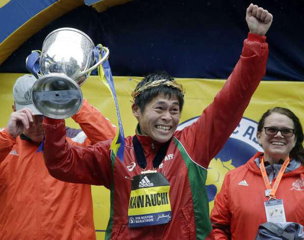 Yuki Kawauchi, of Japan, hoists the trophy after winning the 122nd Boston Marathon on Monday, April 16, 2018, in Boston. He is the first Japanese man to win the race since 1987. (AP Photo/Elise Amendola)