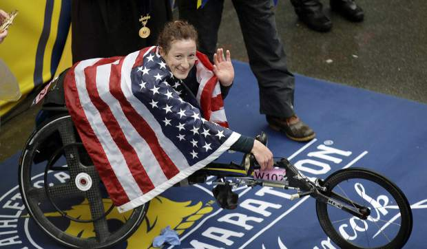 Tatyana McFadden, of the United States, celebrates after winning the women's wheelchair division of the 122nd Boston Marathon on Monday, April 16, 2018, in Boston. (AP Photo/Charles Krupa)