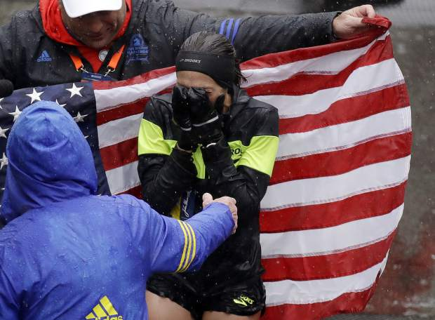 Desiree Linden, of Washington, Mich., celebrates after winning the women's division of the 122nd Boston Marathon on Monday, April 16, 2018, in Boston. She is the first American woman to win the race since 1985. (AP Photo/Charles Krupa)