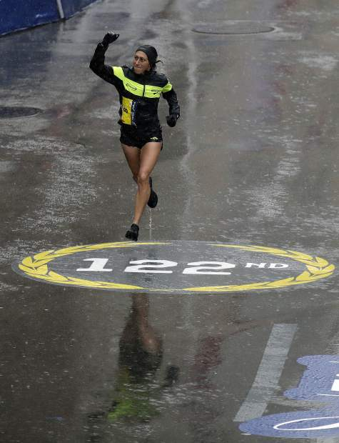 Desiree Linden, of Washington, Mich., approaches the finish line to win the women's division of the 122nd Boston Marathon on Monday, April 16, 2018, in Boston. She is the first American woman to win the race since 1985. (AP Photo/Charles Krupa)