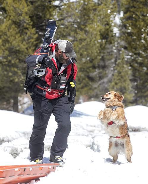 Summit County Search and Rescue's John Reller, and the search dog, Recco, at the trailhead of Georgia Pass Tuesday, April 10, near Breckenridge.