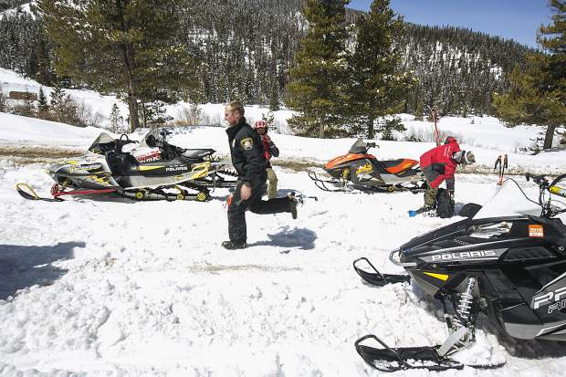 Summit County Sheriff officer Brian Metzger, center, and Summit County Search and Rescue team prepare to head out to the avalanche incident site at Georgia Pass Tuesday, April 10, near Breckenridge.
