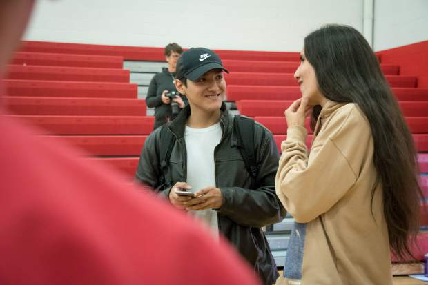 Xiutezcatl Martinez talks with Glenwood Springs High School senior Kevin Gonzalez after his presentation to the school on Thursday morning.