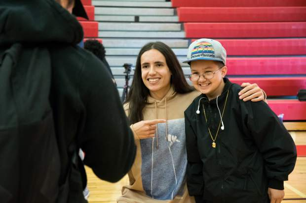Xiutezcatl Martinez talks with Glenwood Springs High School junior Sergio Carrillo after his presentation to the school on Thursday morning.