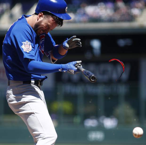 Chicago Cubs' Kris Bryant reacts after taking a pitch to the batting helmet from Colorado Rockies starter German Marquez in the first inning of a baseball game Sunday, April 22, 2018, in Denver. Bryant was pulled from the game after getting hit. (AP Photo/David Zalubowski)