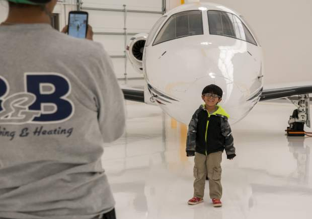 Four-year-old Carlito Salazar gets his photo taken with the airplanes at the annual field trip day at the Rifle-Garfield County Airport on Thursday.
