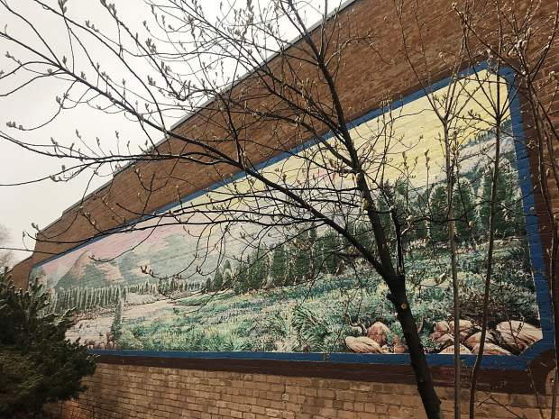 Haberlein originally painted this mural on the side of Carbondale's Dinkel Building in 1989. He restored it in 2010.