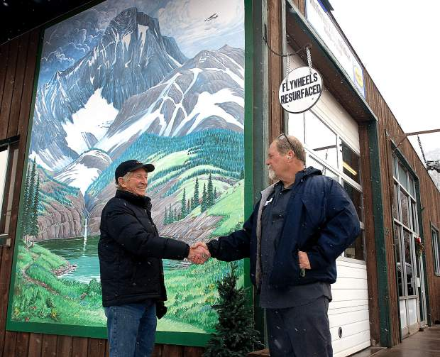 Glenwood Springs business owner Joel Hendershot, right, commissioned local artist Fred