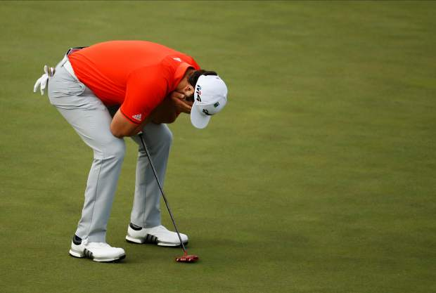 Jon Rahm, of Spain, reacts after missing a par putt on the 15th hole during the fourth round at the Masters golf tournament Sunday, April 8, 2018, in Augusta, Ga. (AP Photo/Charlie Riedel)