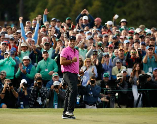 Patrick Reed celebrates after winning the Masters golf tournament Sunday, April 8, 2018, in Augusta, Ga. (AP Photo/Charlie Riedel)