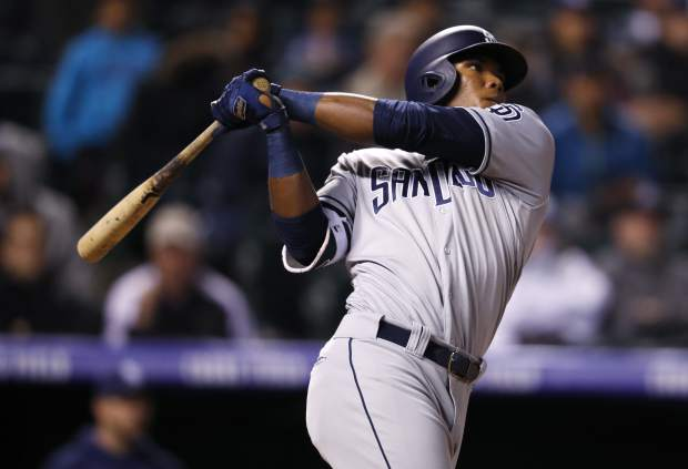 San Diego Padres' Franchy Cordero follows the flight of his 2-run home run off Colorado Rockies relief pitcher Jake McGee in the seventh inning of a baseball game, Monday, April 23, 2018, in Denver. The Padres won 13-5. (AP Photo/David Zalubowski)