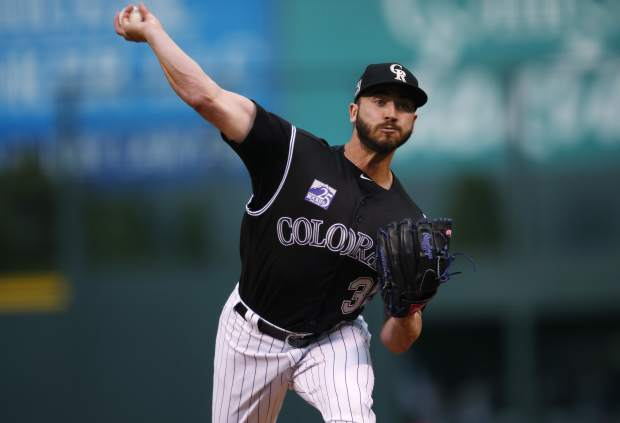 Colorado Rockies starting pitcher Chad Bettis delivers a pitch to San Diego Padres' Franchy Cordero in the first inning of a baseball game Monday, April 23, 2018, in Denver. (AP Photo/David Zalubowski)