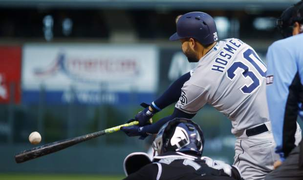 San Diego Padres' Eric Hosmer connects for a single off Colorado Rockies starting pitcher Chad Bettis in the first inning of a baseball game Monday, April 23, 2018, in Denver. (AP Photo/David Zalubowski)