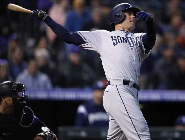 San Diego Padres' Clayton Richard follows the flight of his three-run home run off Colorado Rockies starting pitcher Jon Gray in the fourth inning of a baseball game Monday, April 9, 2018, in Denver. (AP Photo/David Zalubowski)