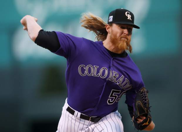 Colorado Rockies starting pitcher Jon Gray delivers to San Diego Padres' Carlos Asuaje in the first inning of a baseball game Monday, April 9, 2018, in Denver. (AP Photo/David Zalubowski)