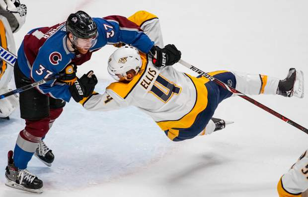 Colorado Avalanche left wing J.T. Compher (37) throws Nashville Predators defenseman Ryan Ellis (4) to the ice during the first period in Game 6 of an NHL hockey first-round playoff series Sunday, April 22, 2018, in Denver. (AP Photo/Jack Dempsey)