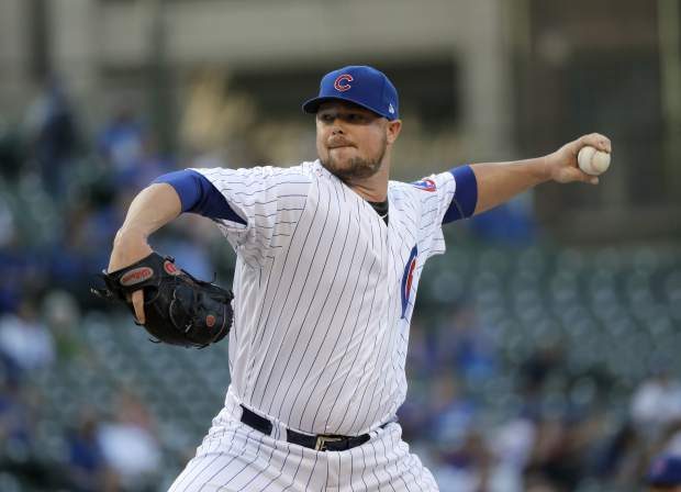 Chicago Cubs starting pitcher Jon Lester delivers during the first inning of a baseball game against the Colorado Rockies Monday, April 30, 2018, in Chicago. (AP Photo/Charles Rex Arbogast)