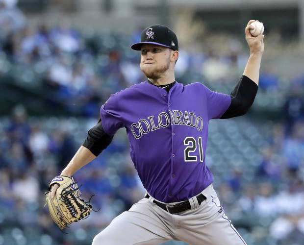 Colorado Rockies starting pitcher Kyle Freeland delivers during the first inning of a baseball game against the Chicago Cubs, Monday, April 30, 2018, in Chicago. (AP Photo/Charles Rex Arbogast)