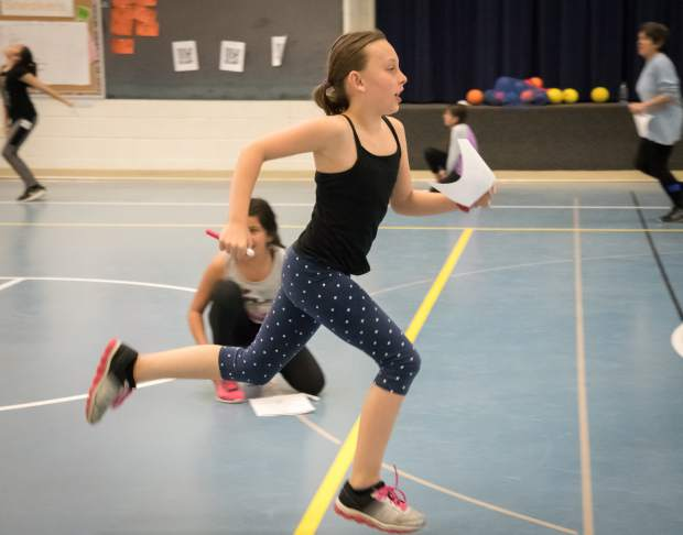 Addison Wiethoff runs laps in the gym during the Wednesday session of Girls on the Run at Cactus Valley Elementary School in Silt. Girls on the Run is a transformational physical activity development program for girls in third through eighth grade. The girls at Cactus Valley are training to run a 5K in Fruita later this spring.