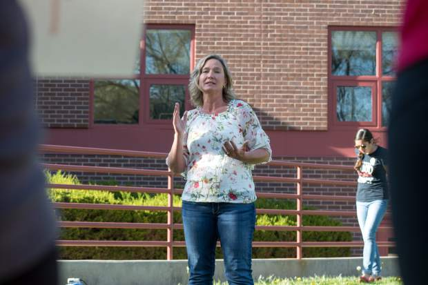 Dendy Heisel speaks to teachers, parents and supporters during the teacher pay rally outside the district office in Glenwood Springs.