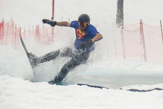 Darren Green wipes out during the pond skim at Snowmass on Sunday for closing weekend.