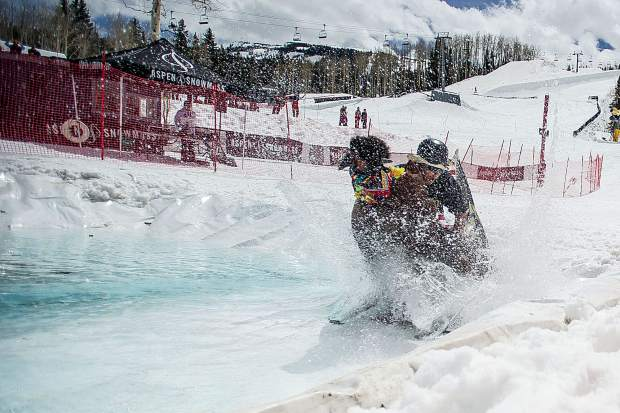 Doug Ward crashes into the pond on his float for the Schneetag competition in Snowmass for closing day on Sunday.