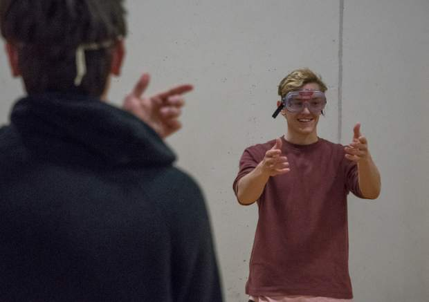 Basalt High School senior Will Orben tries to look straight in front of him while wearing the drunk goggles at Basalt High School.