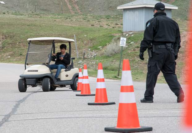 Basalt High School junior Randz Lin attempts to weave in and out of the cones while texting during a driving simulation at the high school on Tuesday.