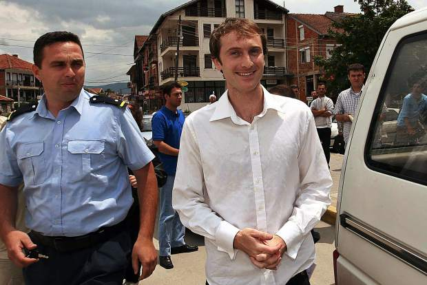 Nicholas Morley, right, of England leaves court in the city of Struga, Macedonia, in June 2007, after getting a two years suspended sentence for the manslaughter of two Macedonians during a car rally. This week, an arrest warrant was filed in Pitkin County District Court for Morley, who is a suspect in the slashing of a $3 million painting last summer at an Aspen gallery.