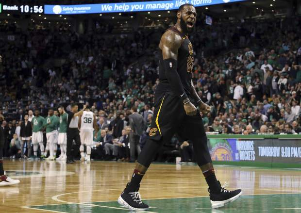 Cleveland Cavaliers forward LeBron James celebrates as his team pulls away from the Boston Celtics near the end of the second half in Game 7 of the NBA basketball Eastern Conference finals, Sunday, May 27, 2018, in Boston. (AP Photo/Elise Amendola)